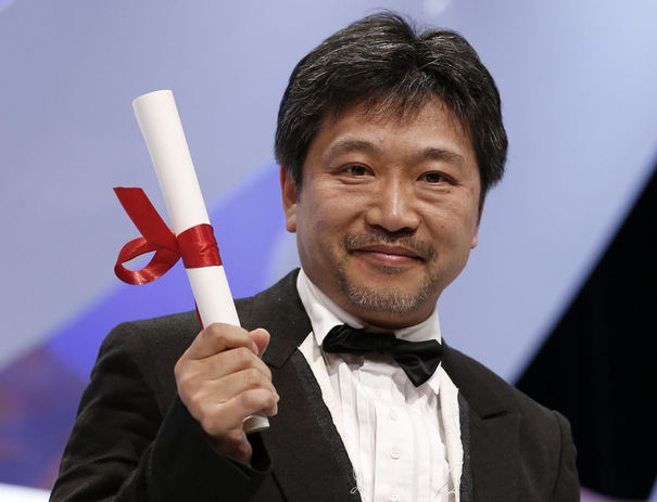 2445077_jury-price-award-winner-director-hirokazu-kore-eda-poses-after-being-awarded-during-the-closing-ceremony-of-the-66th-cannes-film-festival